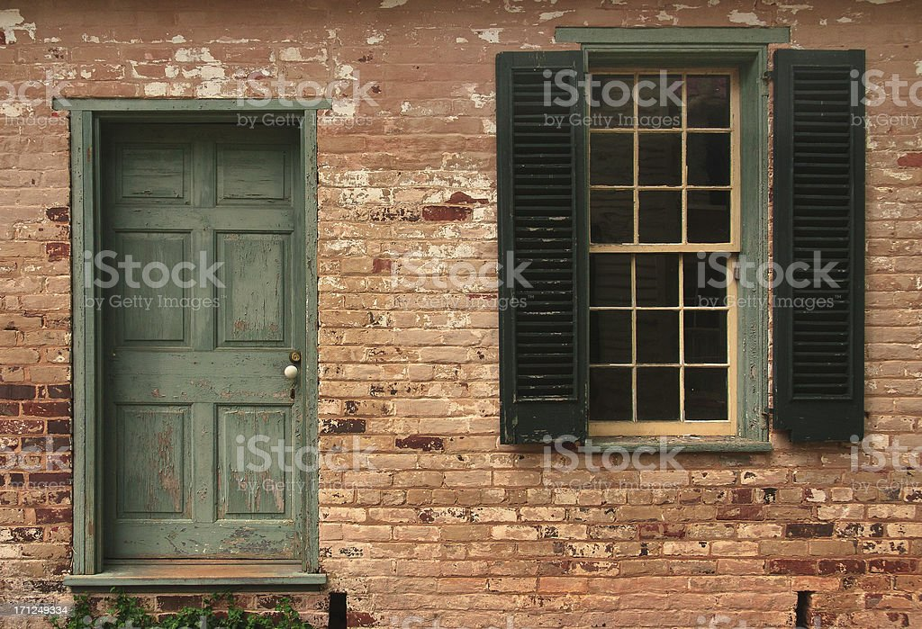 Old Brick Wall, Door & Shuttered Window stock photo