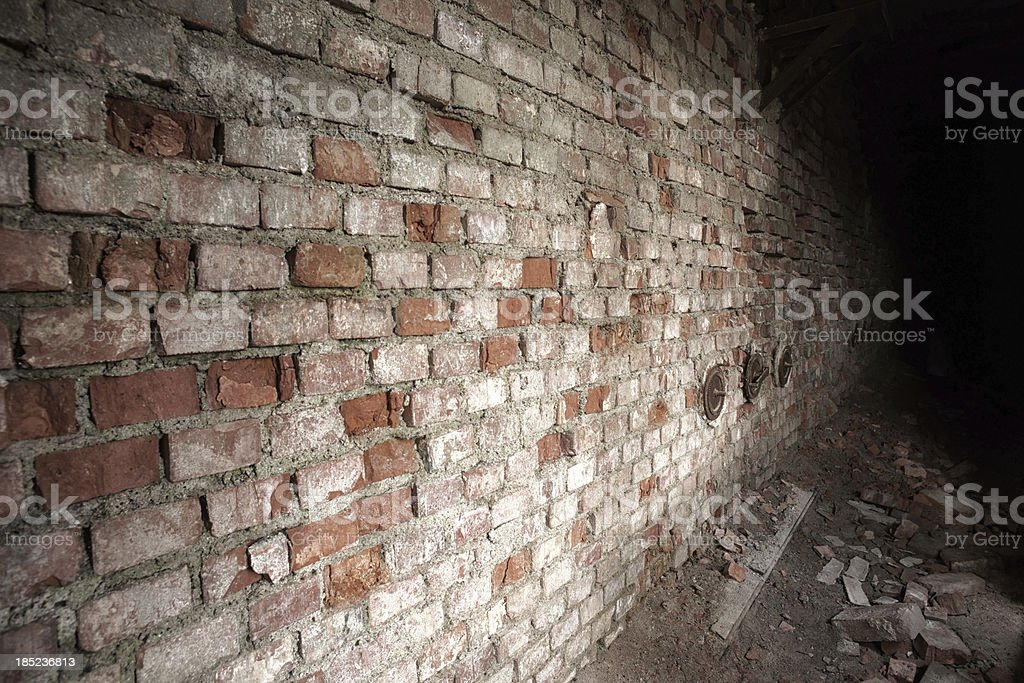 Old brick wall ending in darkness stock photo