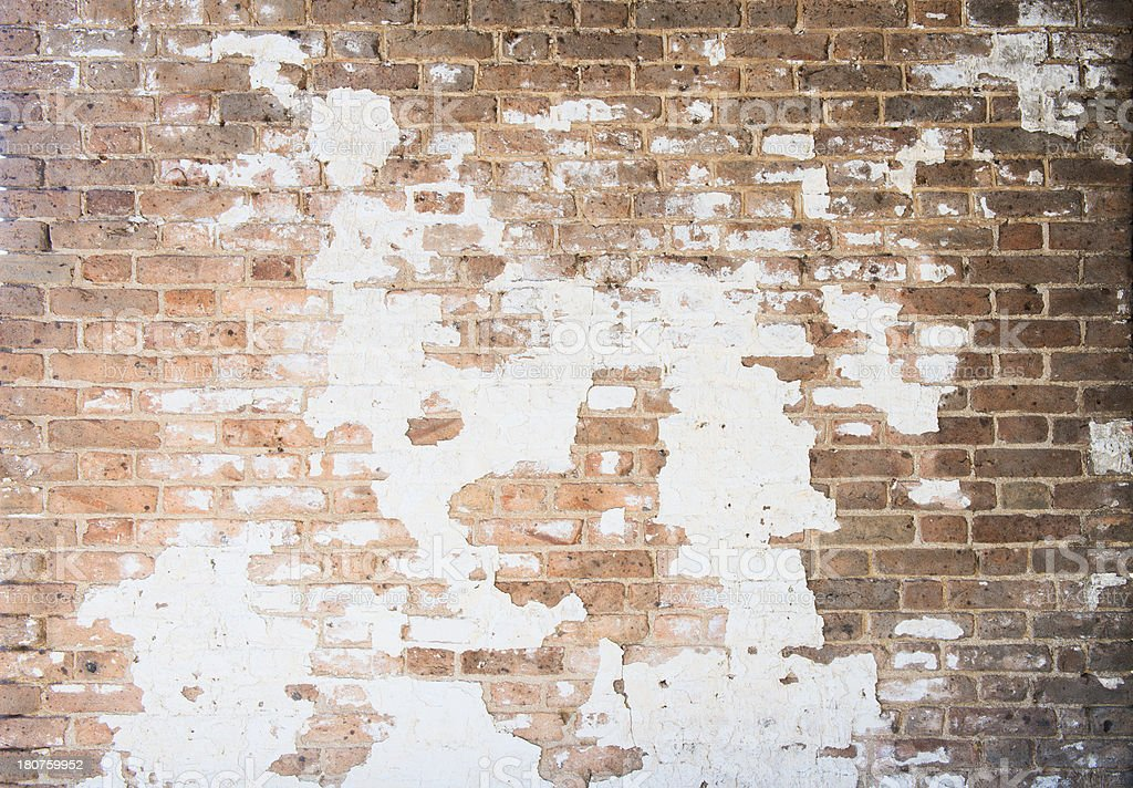 Old Brick Wall Texture with Crumbling Plaster stock photo