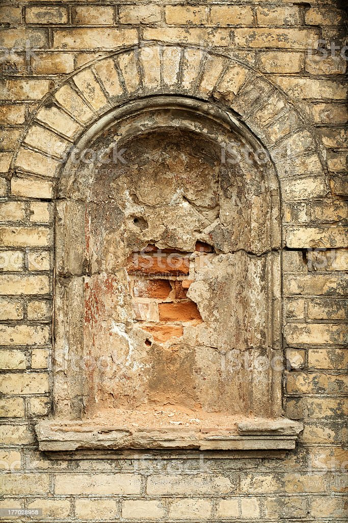Old brick wall with an alcove. royalty-free stock photo
