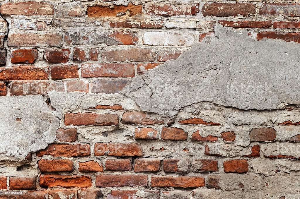 Old brick wall with chipped plaster royalty-free stock photo