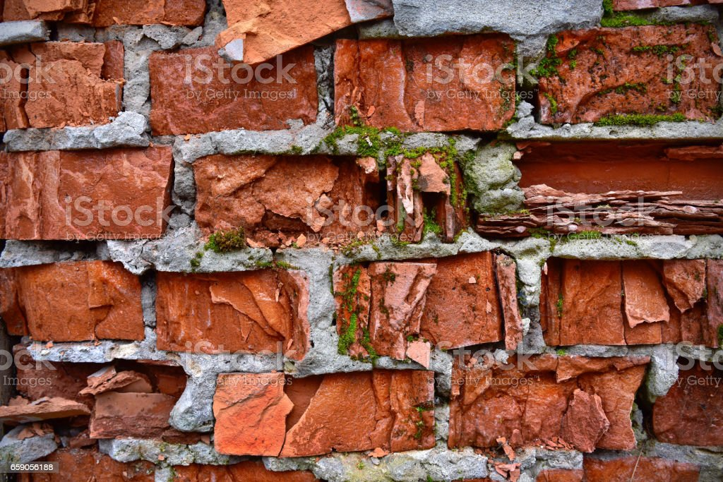 Old brick wall with multicolored bricks stock photo