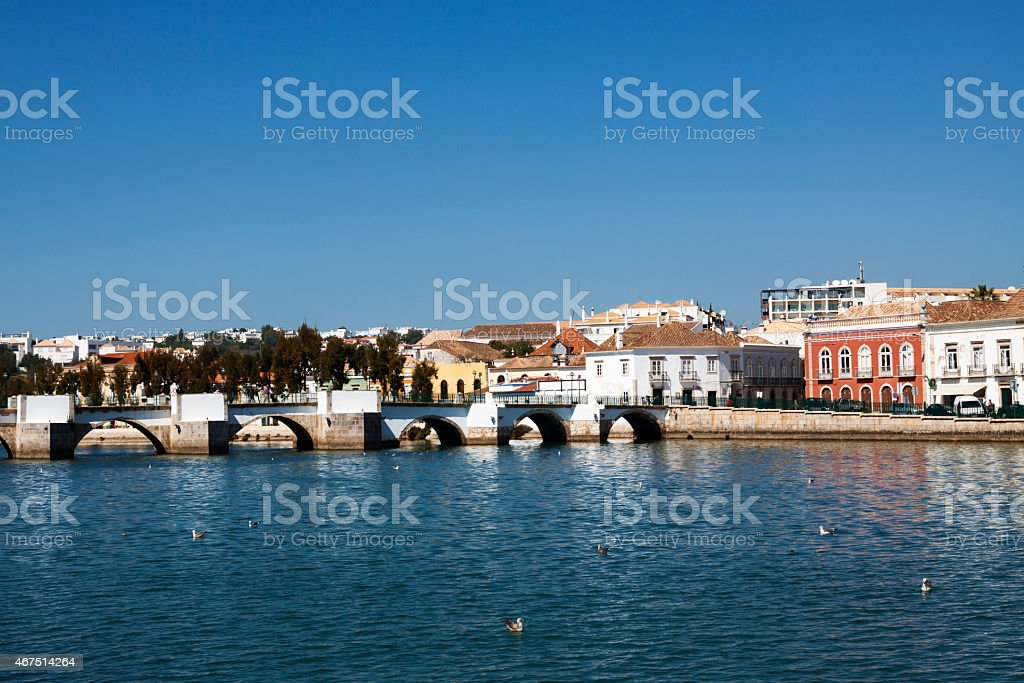 Old bridge and typical Tavira Portugal stock photo