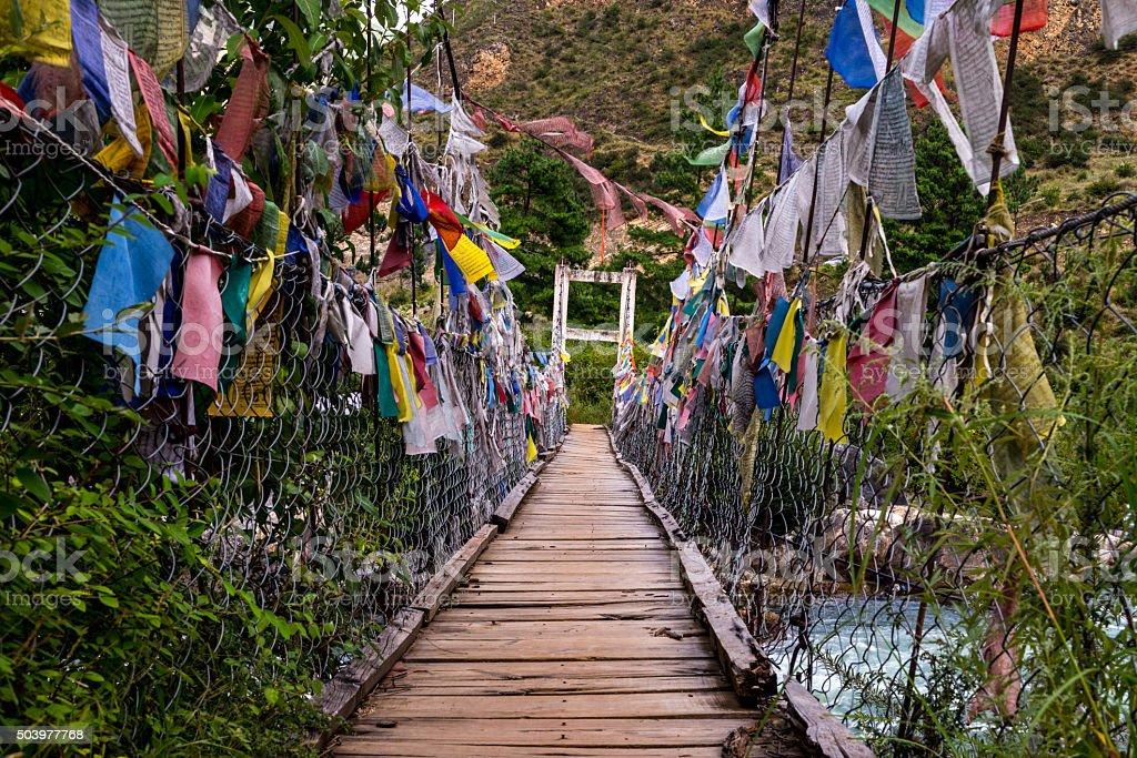 Old Bridge cross to Tamchoe Monastery, Paro province Bhutan stock photo