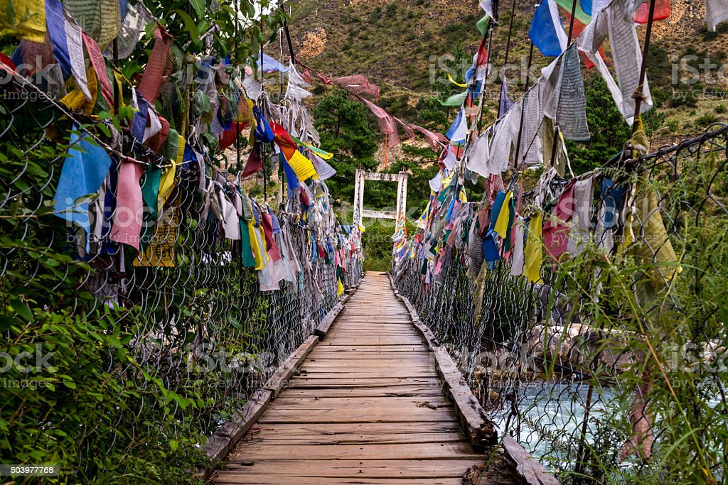 Old Bridge cross to Tamchoe Monastery, Paro province Bhutan stock photo