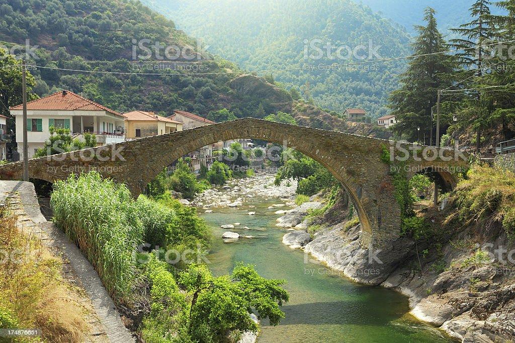 Old bridge in Badalucco stock photo