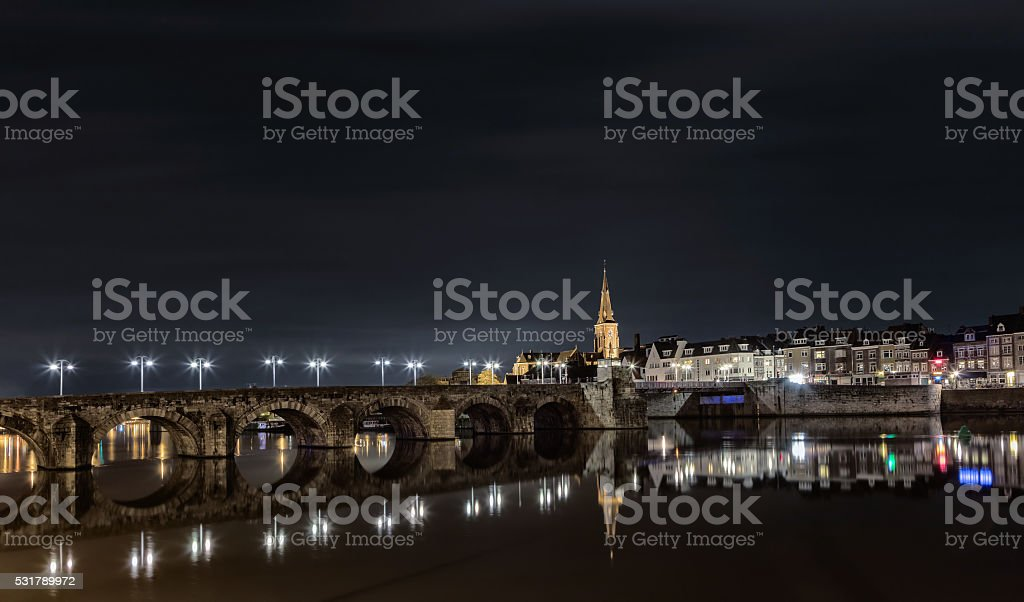 Old bridge in maastricht stock photo