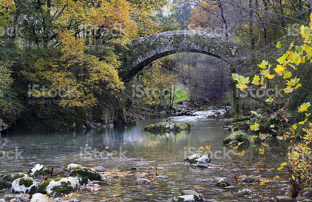 Old bridge on Miera river royalty-free stock photo
