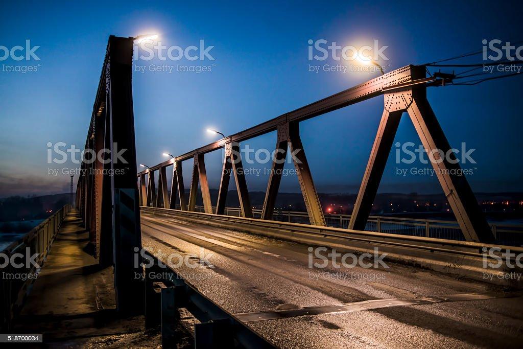 old bridge over river stock photo