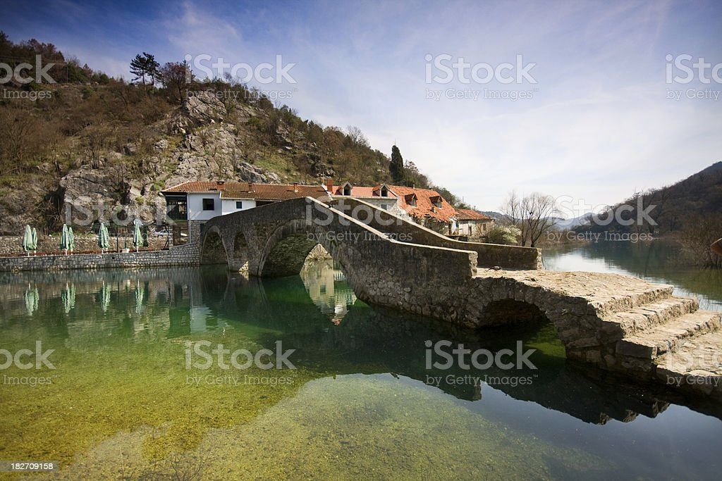 Old bridge over the claer water stock photo