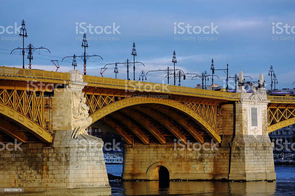 Old bridge over the river at dusk stock photo