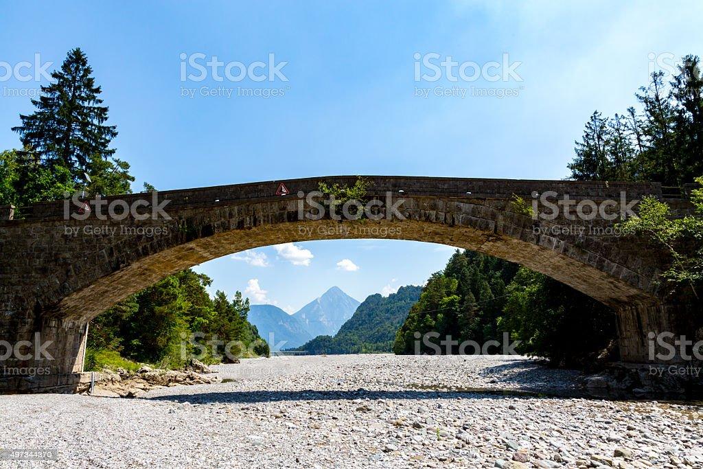 Old bridge over the river stock photo