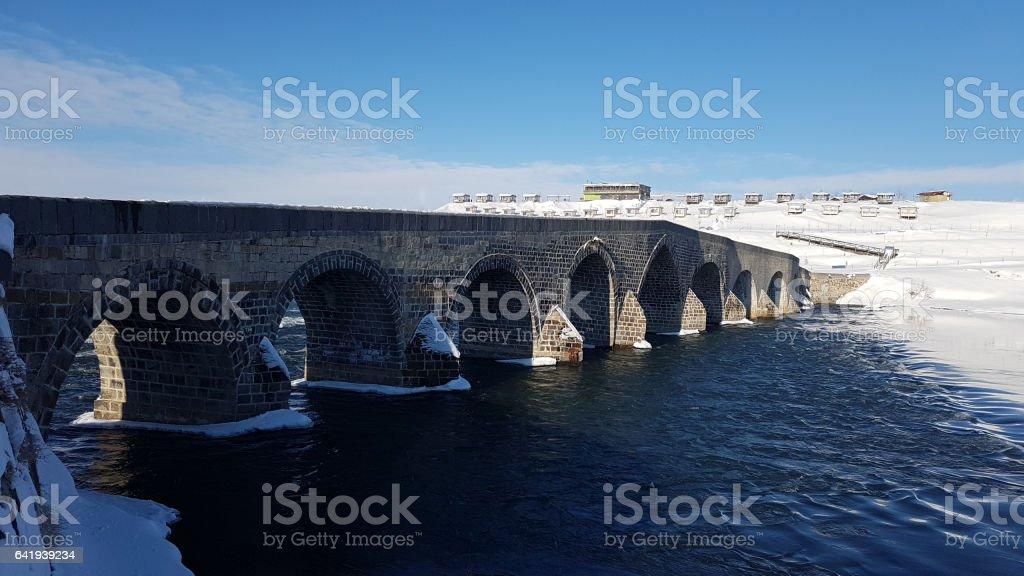 Old Bridge river and snow stock photo