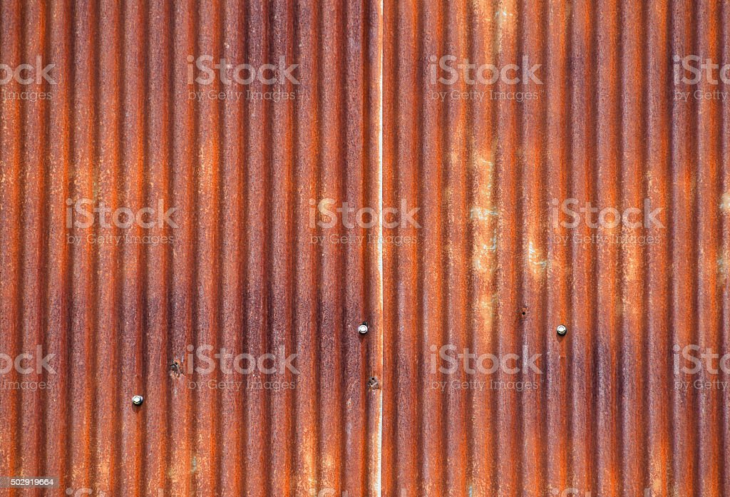 Old bright rust corroded metal goffered surface royalty-free stock photo