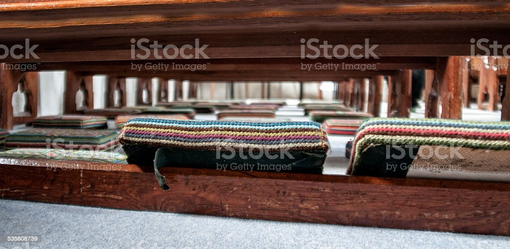 Old brightly coloured embroidered church kneelers/Hassock stock photo