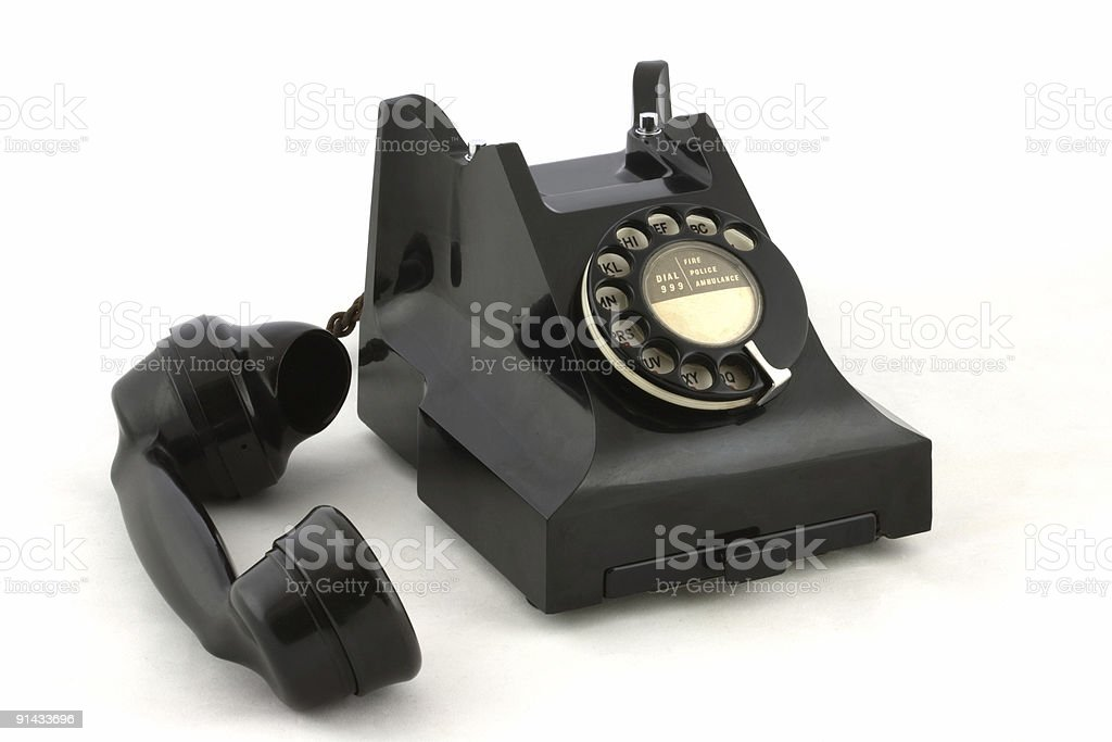 Old British telephone with handset to one side stock photo