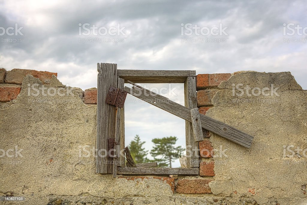 Old broken brick wall with window stock photo
