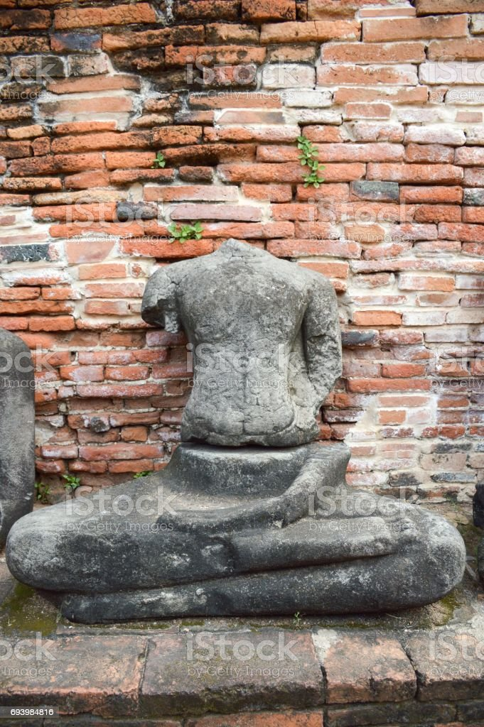 old broken Buddha statue at Chaiwatthanaram Temple, Ayutthaya, Thailand stock photo