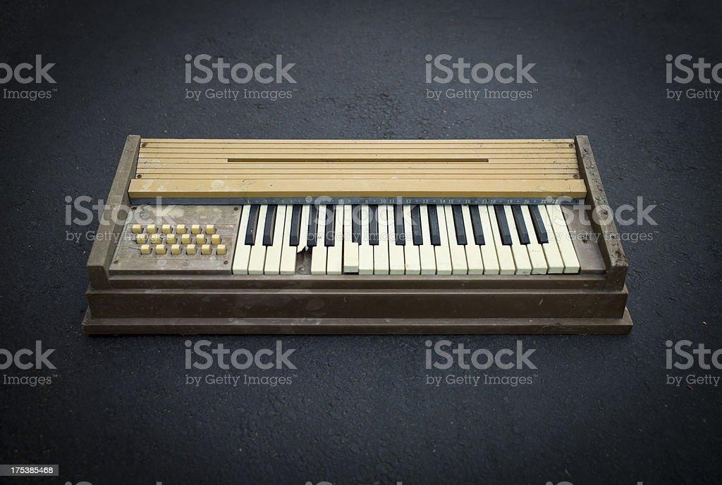 Old broken dirty organ piano keyboard stock photo