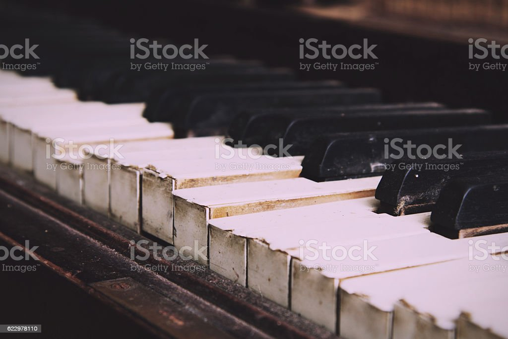 Old broken disused piano with damaged keys Vintage Retro Filter. stock photo