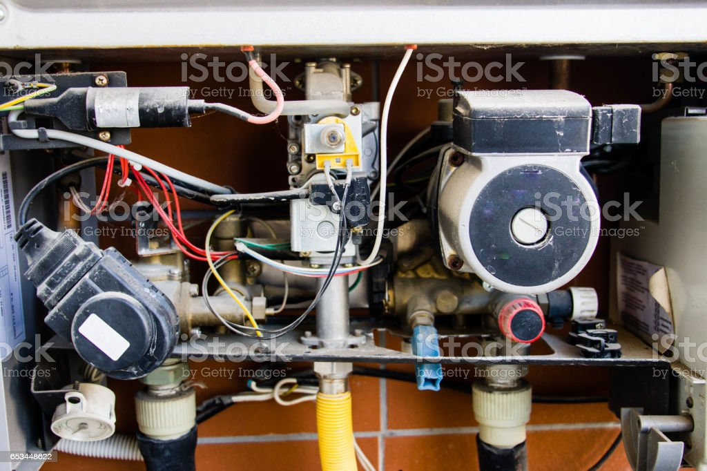 Old broken gas boiler stock photo