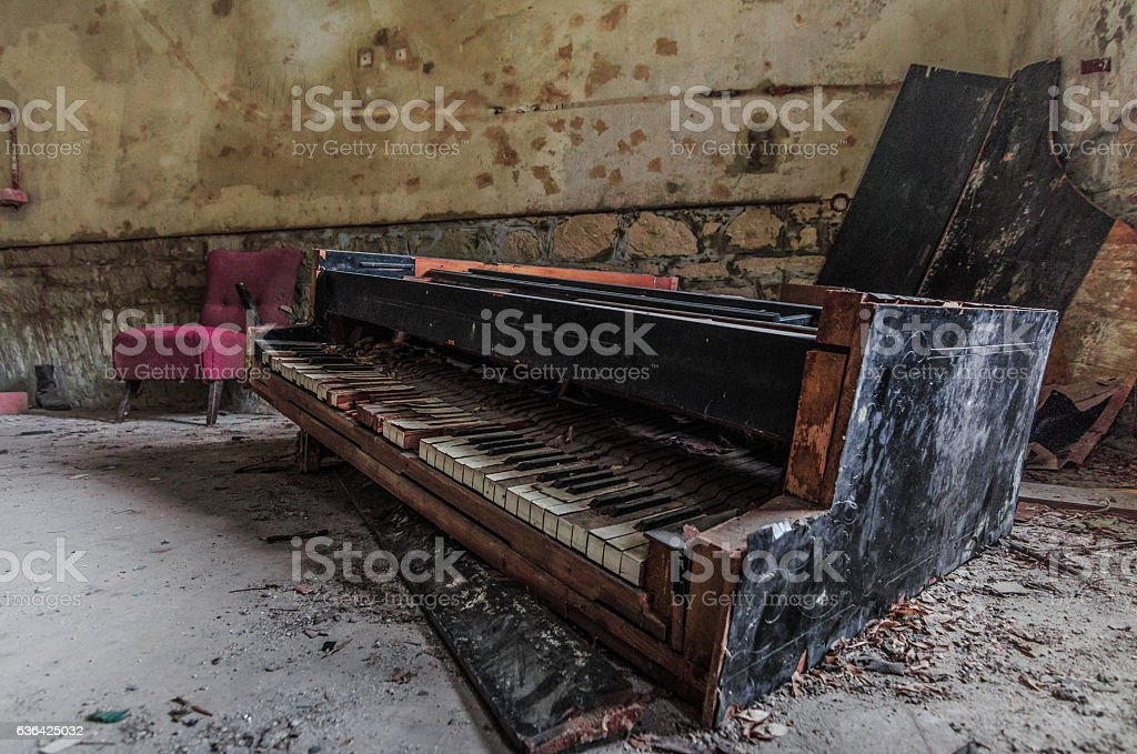 old broken piano stock photo