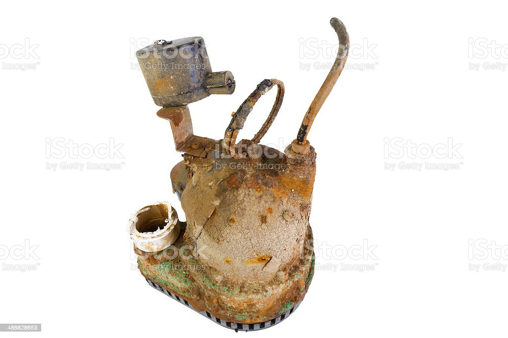 Old broken rusty sump pump stock photo