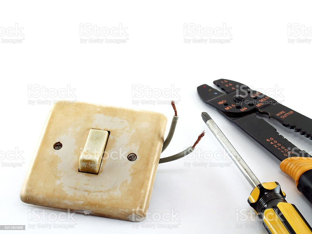 old broken switch, screwdriver and wire stripper stock photo