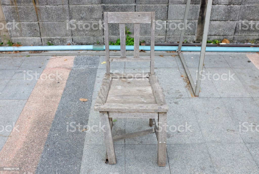 Old broken wood chair in the public park stock photo