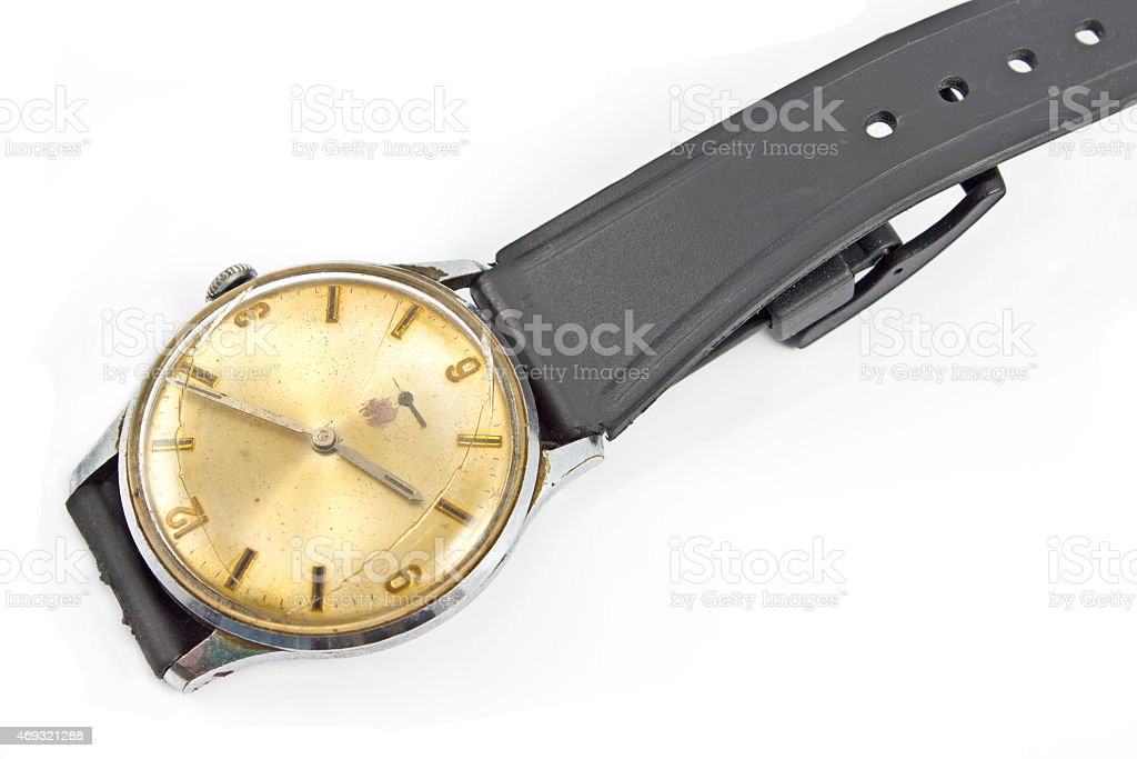 Old broken wristwatch isolated on white stock photo