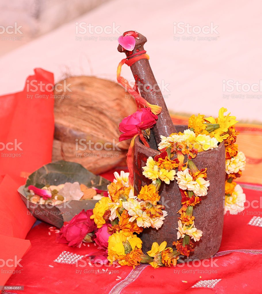 Old bronze mortar and pestle with flowers and coconut stock photo