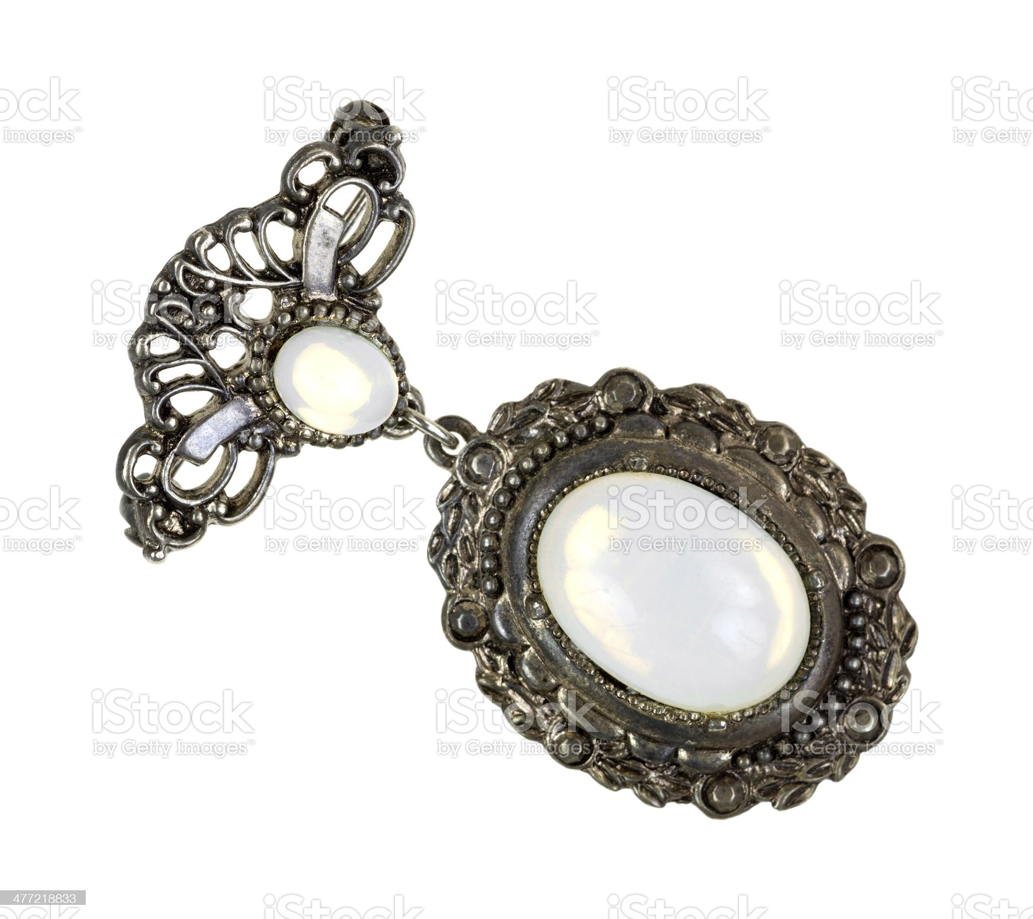 Old brooch with mother of pearl gem royalty-free stock photo