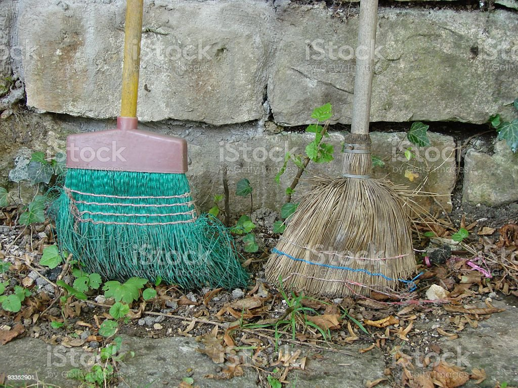 Old brooms stock photo