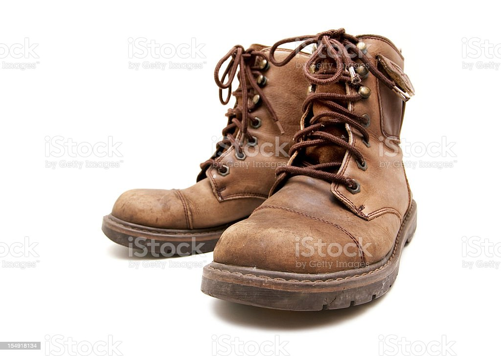 old brown boots isolated on white background royalty-free stock photo