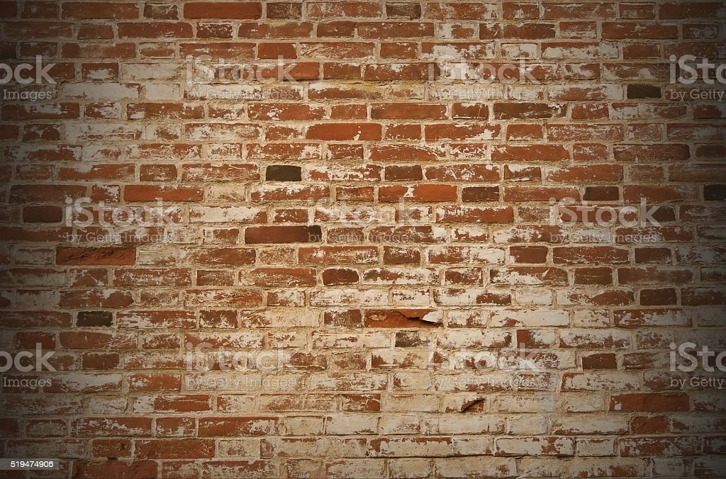 Old brown brick wall in the vignette. stock photo