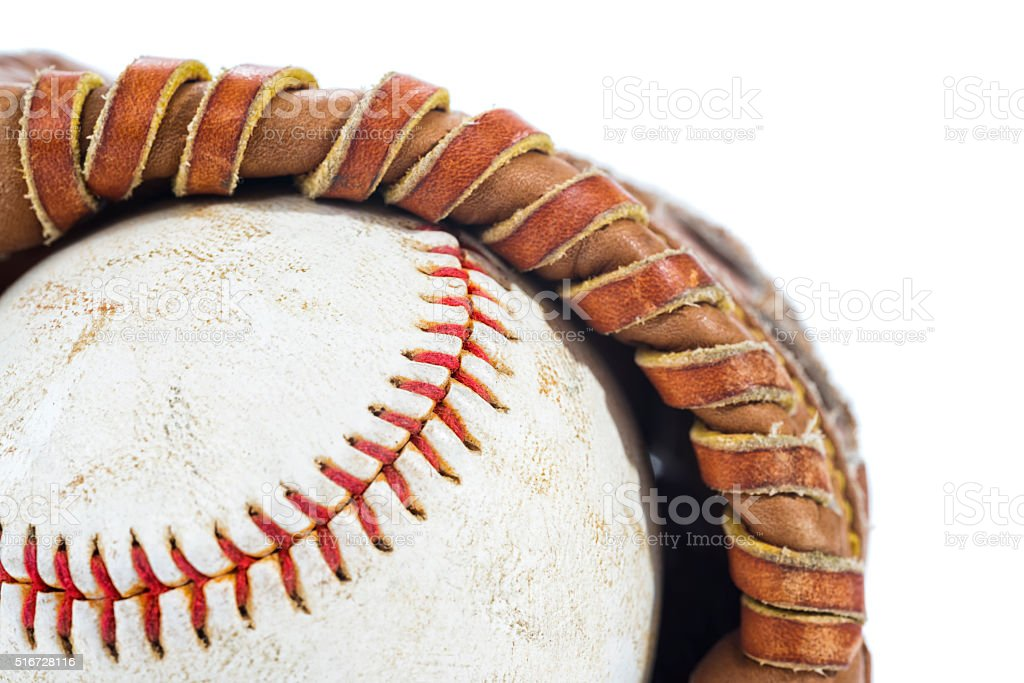 Old brown leather glove and baseball on a white background stock photo