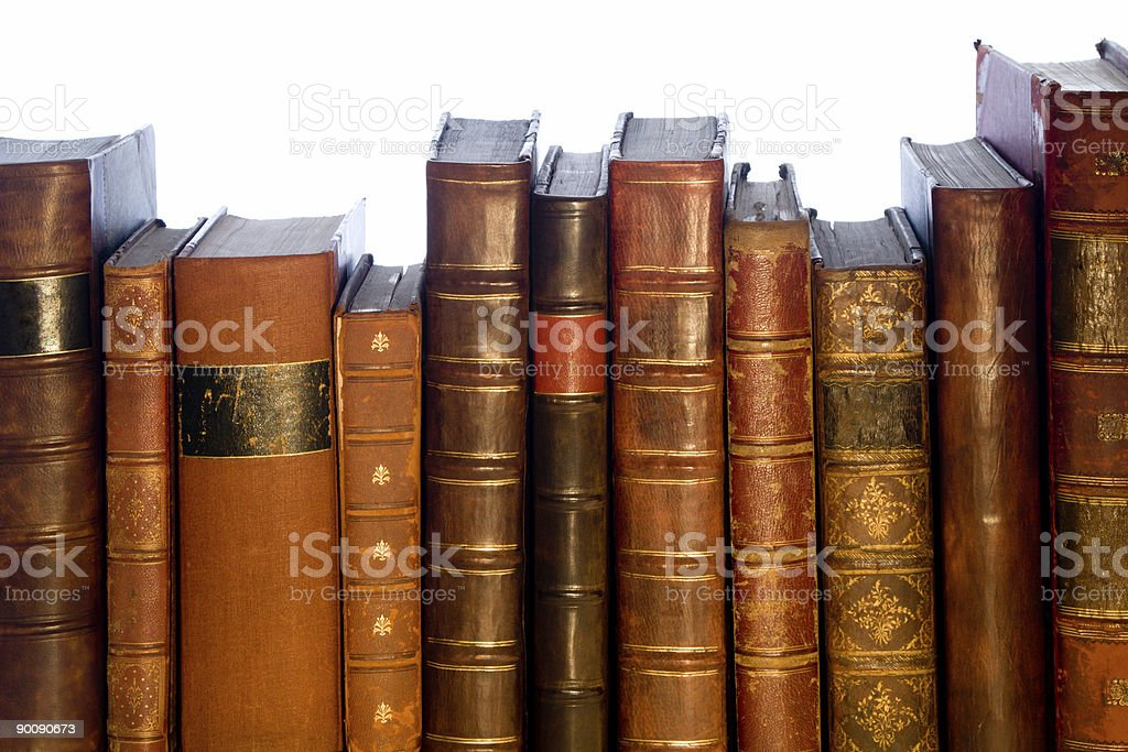Old brown leather-bound books in a row royalty-free stock photo