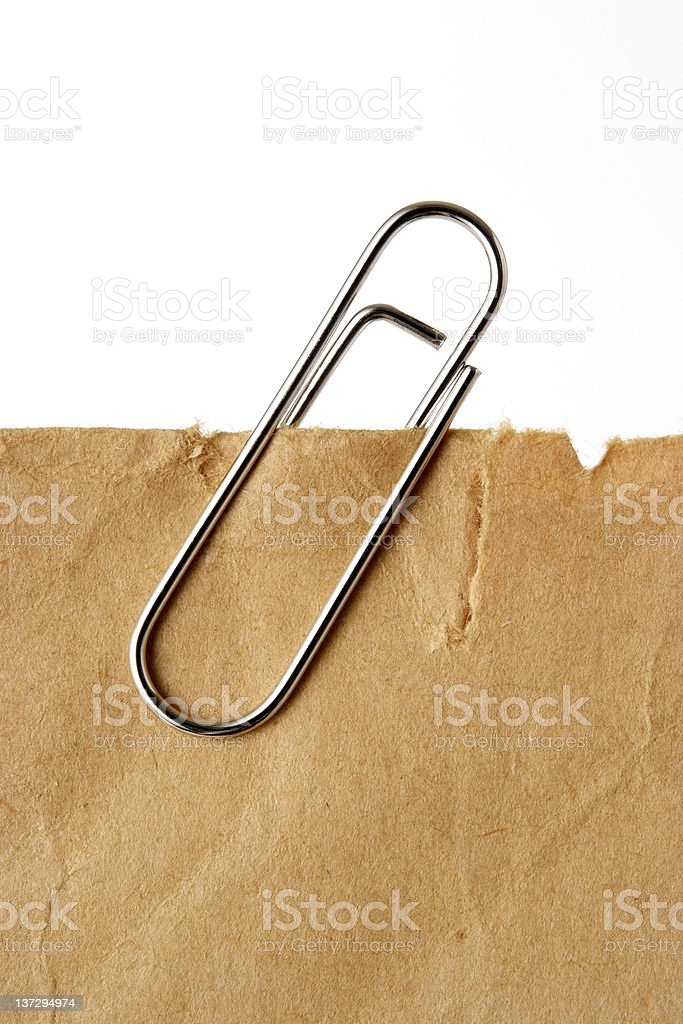 Old brown paper with paper clip on white background royalty-free stock photo