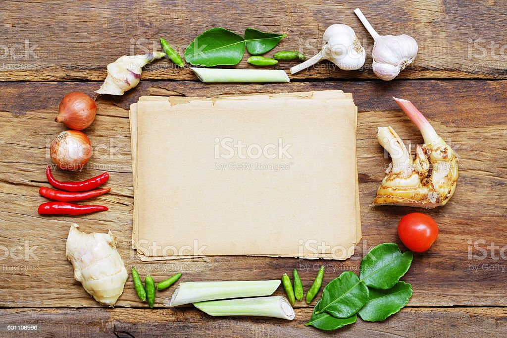 Old brown paper with vegetables on wooden table stock photo