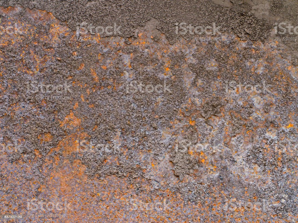Old brown rusty metal plate is aged and corroded. stock photo