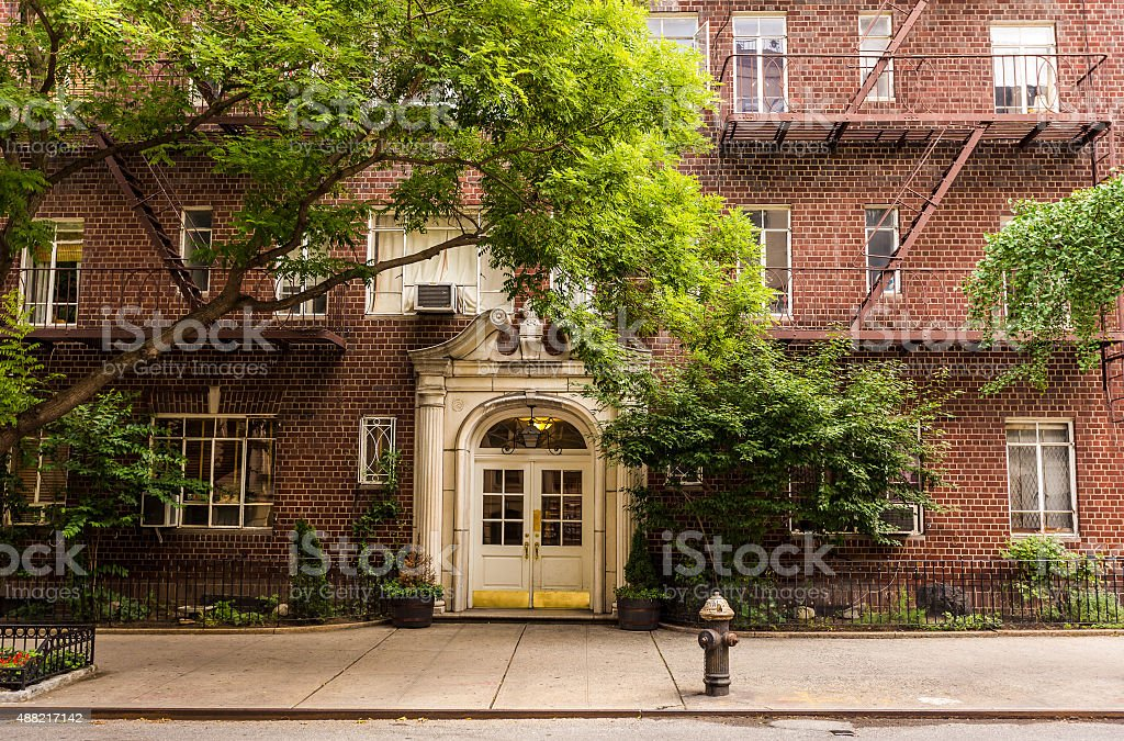 Old brownstone apartment building in Manhattan, New York city. stock photo