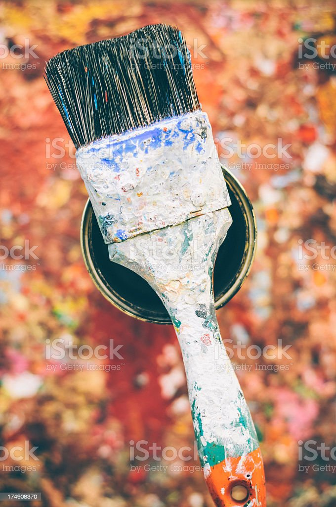 Old brush lying on a tin can royalty-free stock photo