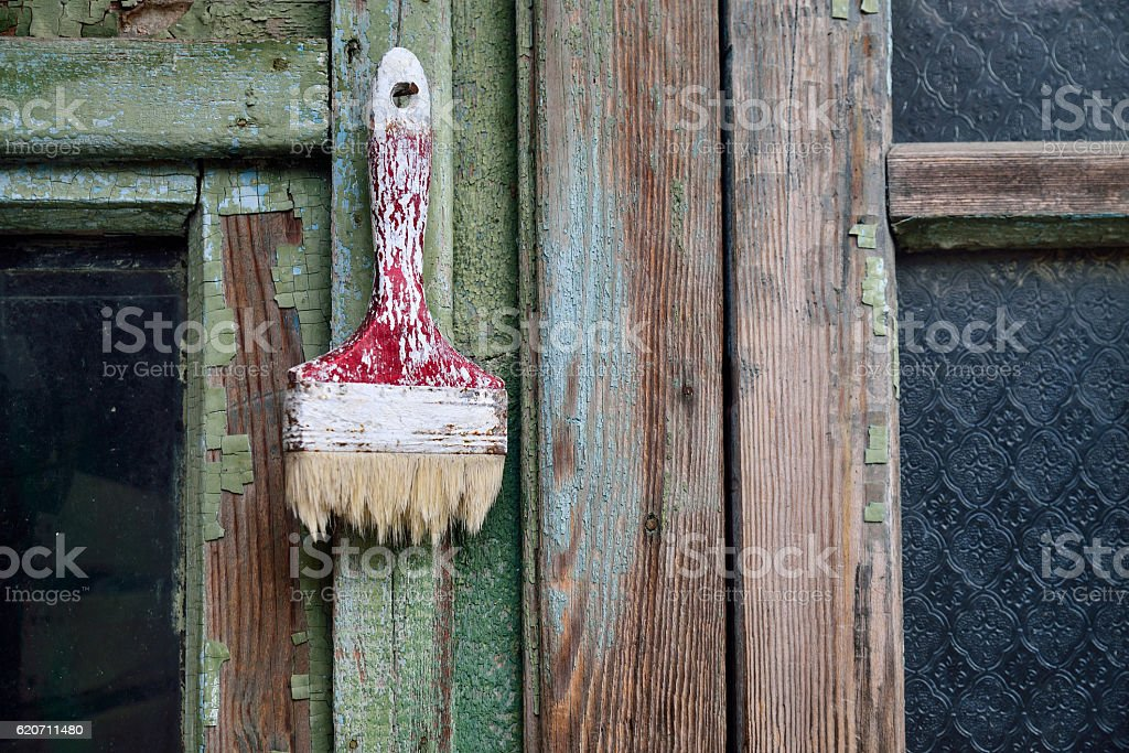 Old brush on the green wooden background stock photo