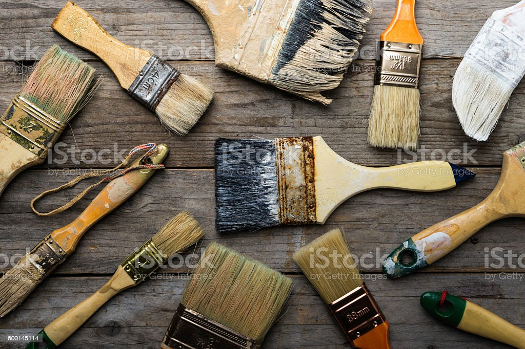 old brushes on the wood table stock photo