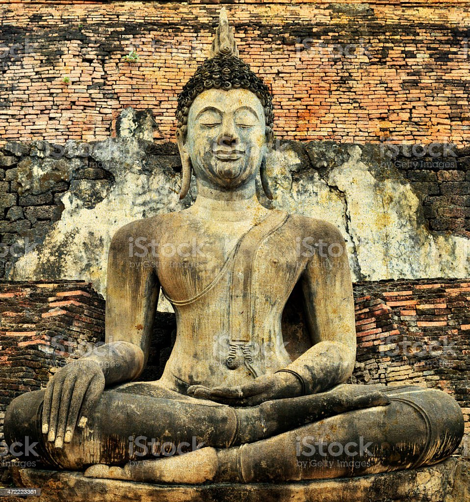 Old Buddha Statue at Wat Mahathat Temple in Sukhothai Historical stock photo