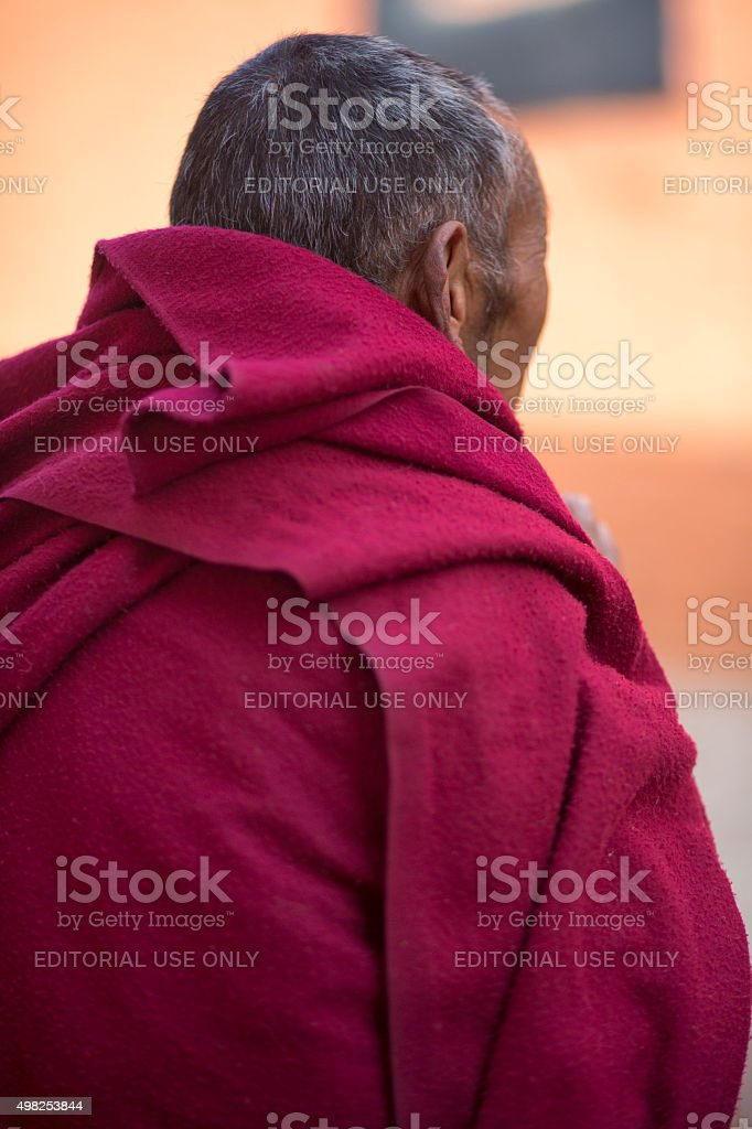 Old buddhist monk in Tibet stock photo