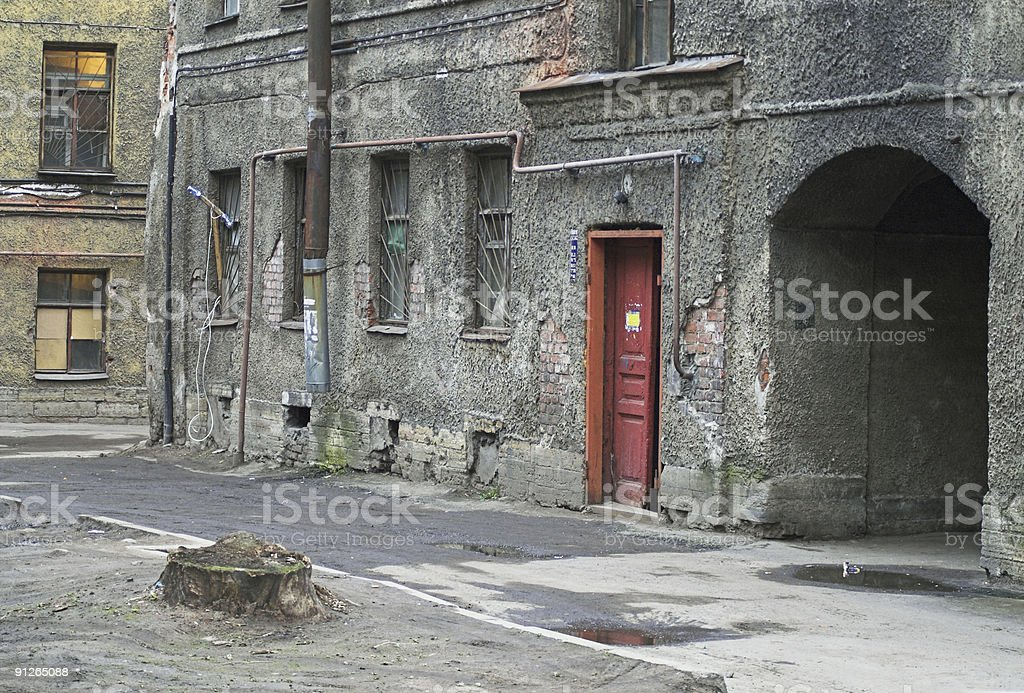 Old building and arch in back alley stock photo