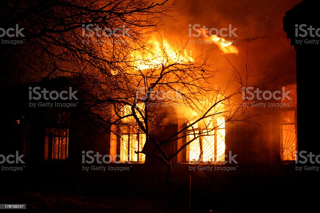 Old building being destroyed by full flaming inferno stock photo