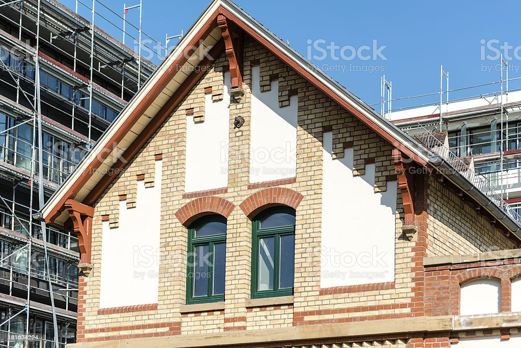 old building in front of modern royalty-free stock photo