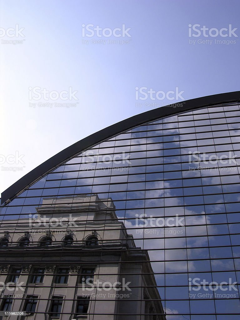 Old Building Reflection On A Modern Architecture Structure royalty-free stock photo